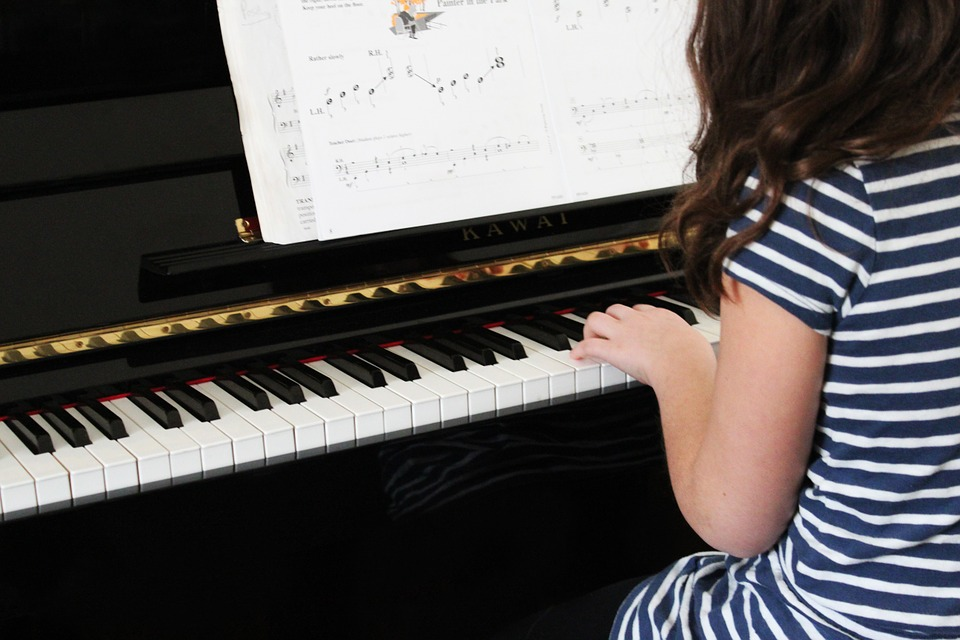 Girls Playing Piano with Chords